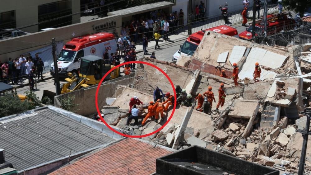 Resgate dos bombeiros de vítima sob escombros do Edifício Andrea.